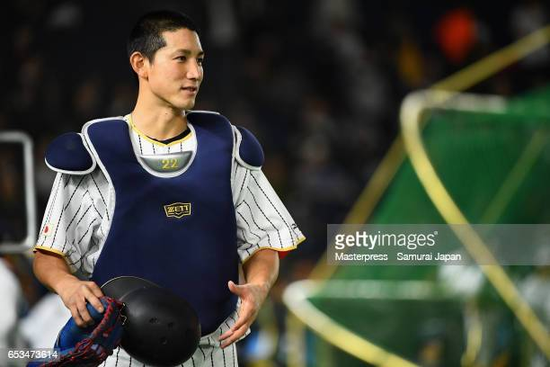 Catcher Seiji Kobayashi of Japan is seen prior to the World Baseball Classic Pool E Game Six between Israel and Japan at the Tokyo Dome on March 15...