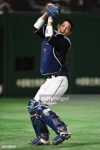 Catcher Seiji Kobayashi of Japan makes a catch a pop fly hit by Outfielder Kalian Sams of the Netherlands to win by 86 in the bottom of eleventh...
