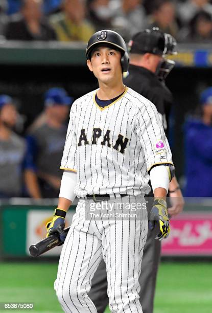 Catcher Seiji Kobayashi of Japan reacts after striking out in the bottom of the second inning during the World Baseball Classic Pool E Game Six...