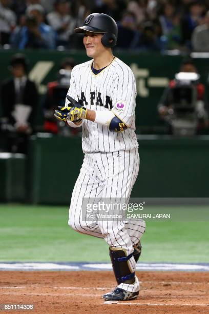 Catcher Seiji Kobayashi of Japan runs after hitting a two run homer in the bottom of the second inning during the World Baseball Classic Pool B Game...