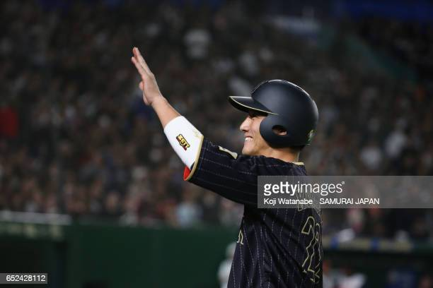 Catcher Seiji Kobayashi of Japan smiles after the top of the fifth inning hitting a RBI single to make it 65 during the World Baseball Classic Pool E...