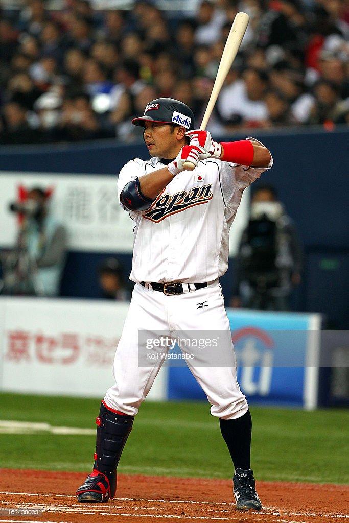Catcher Shinnosuke Abe #10 of Japan at bat during international friendly game between Japan and Australia at Kyocera Dome Osaka on February 23, 2013 in Osaka, Japan.