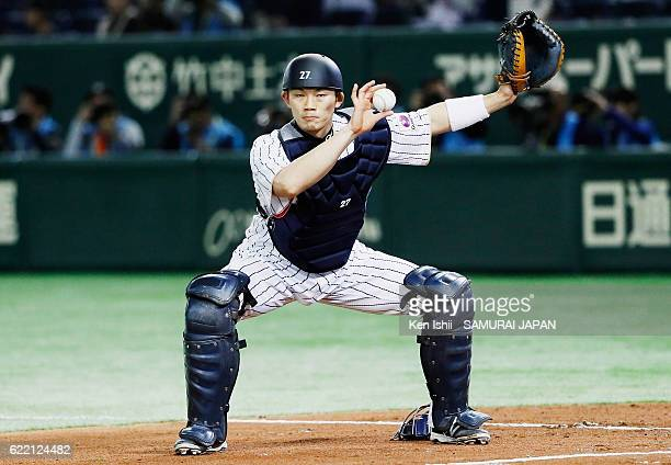 Catcher Shota Ohno of Japan celebrates a strike out in the first inning during the international friendly match between Japan and Mexico at the Tokyo...