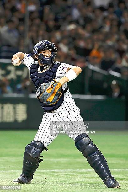 Catcher Shota Ohno of Japan throws during the international friendly match between Japan and Netherlands at the Tokyo Dome on November 12 2016 in...