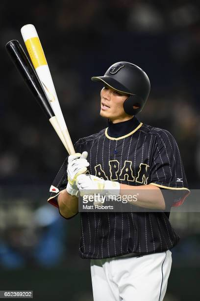 Catcher Shota Ohno of Japan warms up prior to the World Baseball Classic Pool E Game Two between Japan and Netherlands at the Tokyo Dome on March 12...