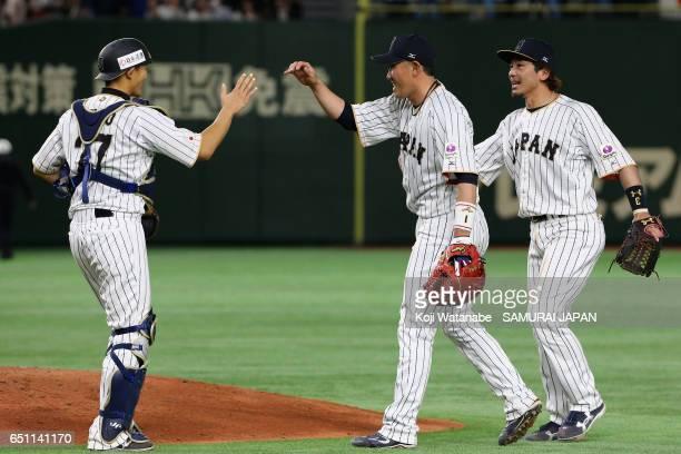 Catcher Shota Ohno Outfielder Seiichi Uchikawa and Infielder Nobuhiro Matsuda of Japan celebrate their win after the World Baseball Classic Pool B...