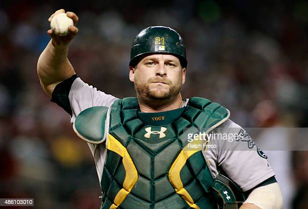 Catcher Stephen Vogt of the Oakland Athletics throws a baseball to the crowd during the sixth inning of a MLB game against the Arizona Diamondbacks...