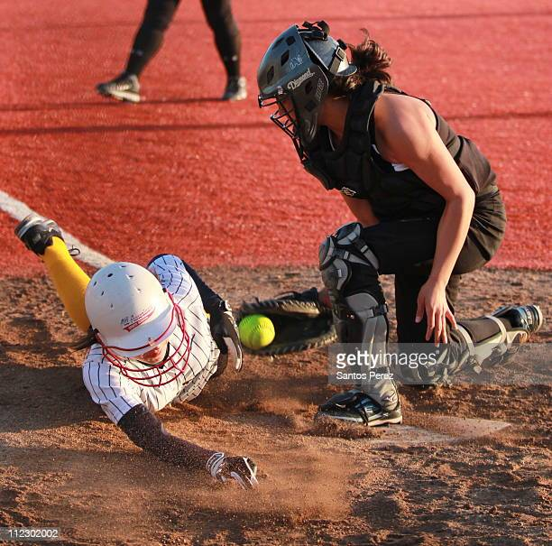 Catcher tags a runner out at the plate during a non-league matchup against Milpitas High on Tuesday, March 8th. Christopher won the game in extra...