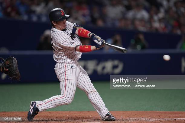 Catcher Takuya Kai of Japan hits a RBI double to make it 56 in the bottom of 8th inning during the game five between Japan and MLB All Stars at...