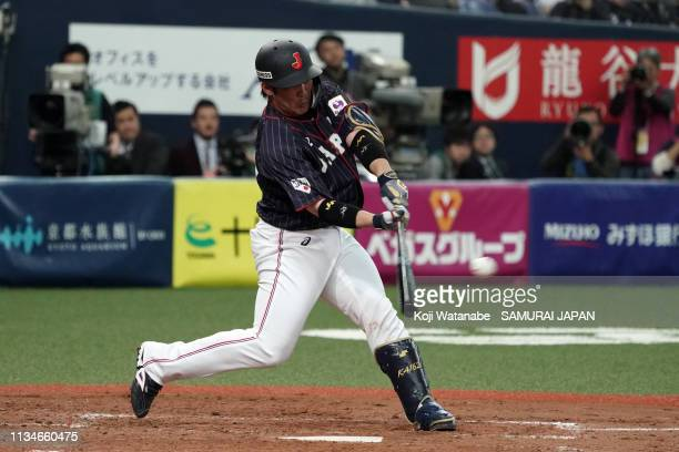 Catcher Takuya Kai of Japan hits a RBI single to make it 20 in the top of 4th inning during the game one between Japan and Mexico at Kyocera Dome...