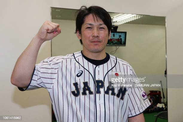 Catcher Takuya Kai of Japan poses for photographs after the game five between Japan and MLB All Stars at Nagoya Dome on November 14, 2018 in Nagoya,...