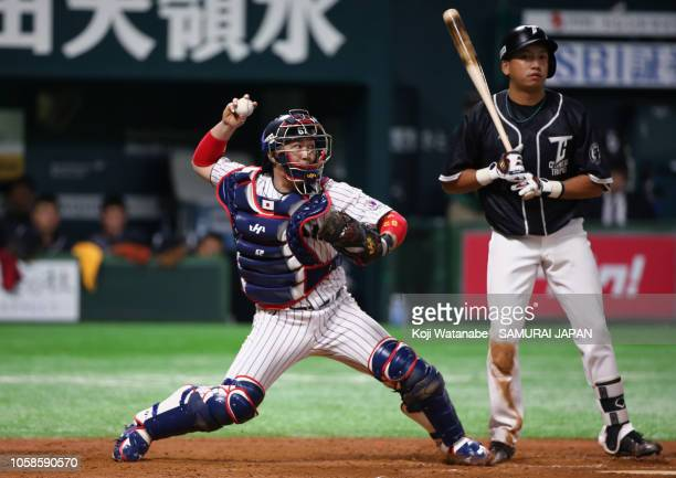 Catcher Takuya Kai of Japan throws to the second base to tag out Infielder Wang WeiChen of Chinese Taipei in the top of 9th inning during the...
