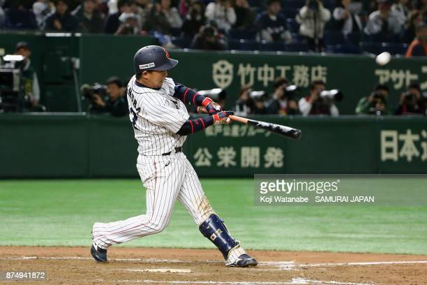 Catcher Tatsuhiro Tamura of Japan hits a gameending double in the bottom of tenth inning during the Eneos Asia Professional Baseball Championship...