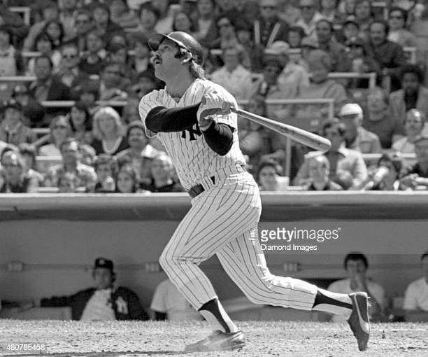 Catcher Thurman Munson of the New York Yankees flies out to end the bottom of the second inning of a game on April 30, 1977 against the Seattle...