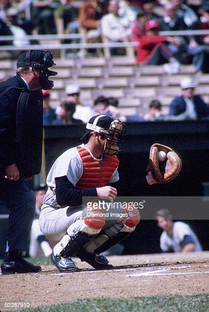 Catcher Thurman Munson of the New York Yankees frames a pitch during an April 1971 game against the Washington Senators at RFK Stadium in Washington...