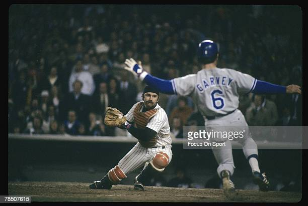Catcher Thurman Munson of the New York Yankees prepares to put the tag on the sliding Steve Garvey of the Los Angeles Dodgers during Game 1 of the...
