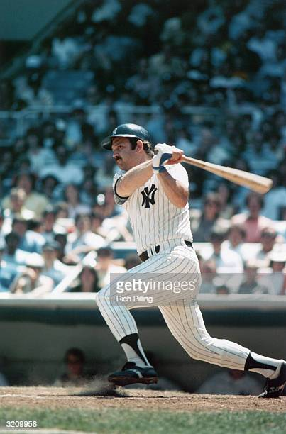 Catcher Thurman Munson of the New York Yankees swings at a pitch circa 1969-79 at Yankee Stadium in the Bronx, New York.
