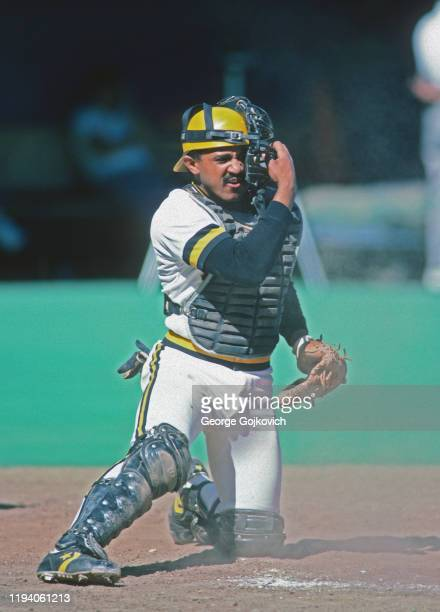 Catcher Tony Pena of the Pittsburgh Pirates adjusts his face mask during a Major League Baseball game at Three Rivers Stadium in 1986 in Pittsburgh,...
