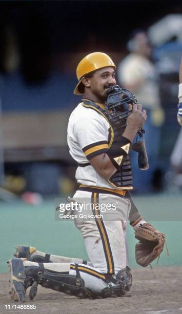 Catcher Tony Pena of the Pittsburgh Pirates holds his mask to his face as he smiles during a Major League Baseball game at Three Rivers Stadium in...