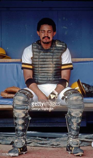 Catcher Tony Pena of the Pittsburgh Pirates sits in the dugout after playing in both games of a Major League Baseball doubleheader at Three Rivers...