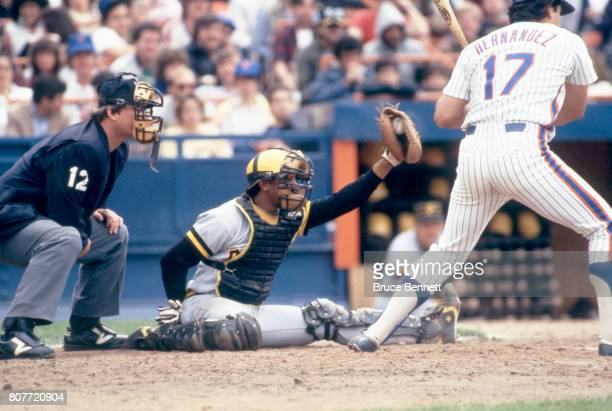Catcher Tony Pena of the Pittsburgh Pirates sits on the ground as Keith Hernandez of the New York Mets takes the pitch during an MLB game circa 1985...