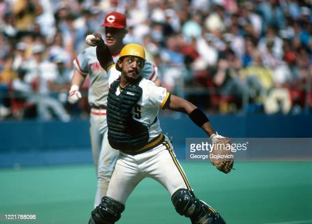 Catcher Tony Pena of the Pittsburgh Pirates throws the ball in an attempt to catch a runner off base after forcing out Buddy Bell of the Cincinnati...
