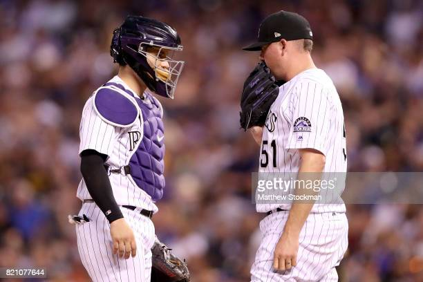 Catcher Tony Wolters and pitcher Jake McGee of the Colorado Rockies confer in the eighth inning against the Pittsburgh Pirates at Coors Field on July...