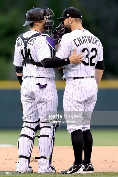 Catcher Tony Wolters and starting pitcher Tyler Chatwood of the Colorado Rockies confer in the fitrst inning against the Washington Nationals at...
