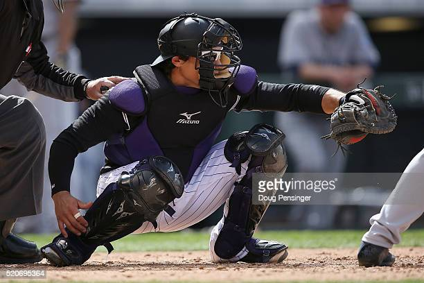 Catcher Tony Wolters of the Colorado Rockies backs up the plate against the San Diego Padres at Coors Field on April 10 2016 in Denver Colorado The...