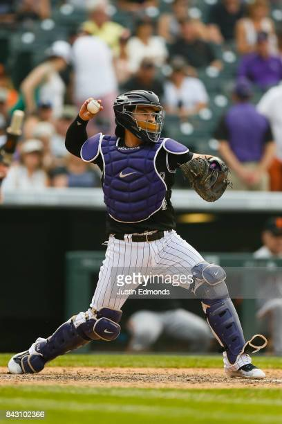 Catcher Tony Wolters of the Colorado Rockies throws to second base against the San Francisco Giants at Coors Field on September 4 2017 in Denver...