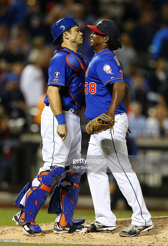 Catcher Travis d'Arnaud #15 and Jenrry Mejia #58 of the New York Mets chest bump after getting the final out in the ninth inning during a game against the Texas Rangers on July 4, 2014 at Citi Field in the Flushing neighborhood of the Queens borough of New York City. The Mets defeated the Rangers 6-5.
