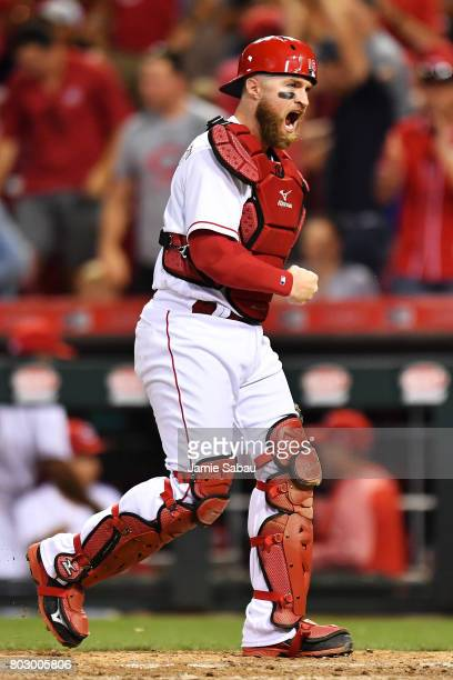 Catcher Tucker Barnhart of the Cincinnati Reds celebrates with a fist pump after throwing out Orlando Arcia of the Milwaukee Brewers at second base...