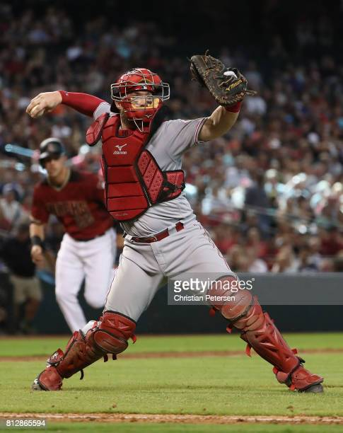 Catcher Tucker Barnhart of the Cincinnati Reds in action during the MLB game against the Arizona Diamondbacks at Chase Field on July 9 2017 in...