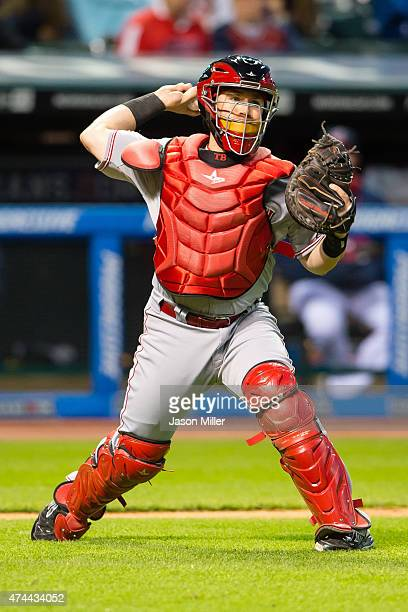 Catcher Tucker Barnhart of the Cincinnati Reds throws out Jason Kipnis of the Cleveland Indians at first to end the fifth inning at Progressive Field...
