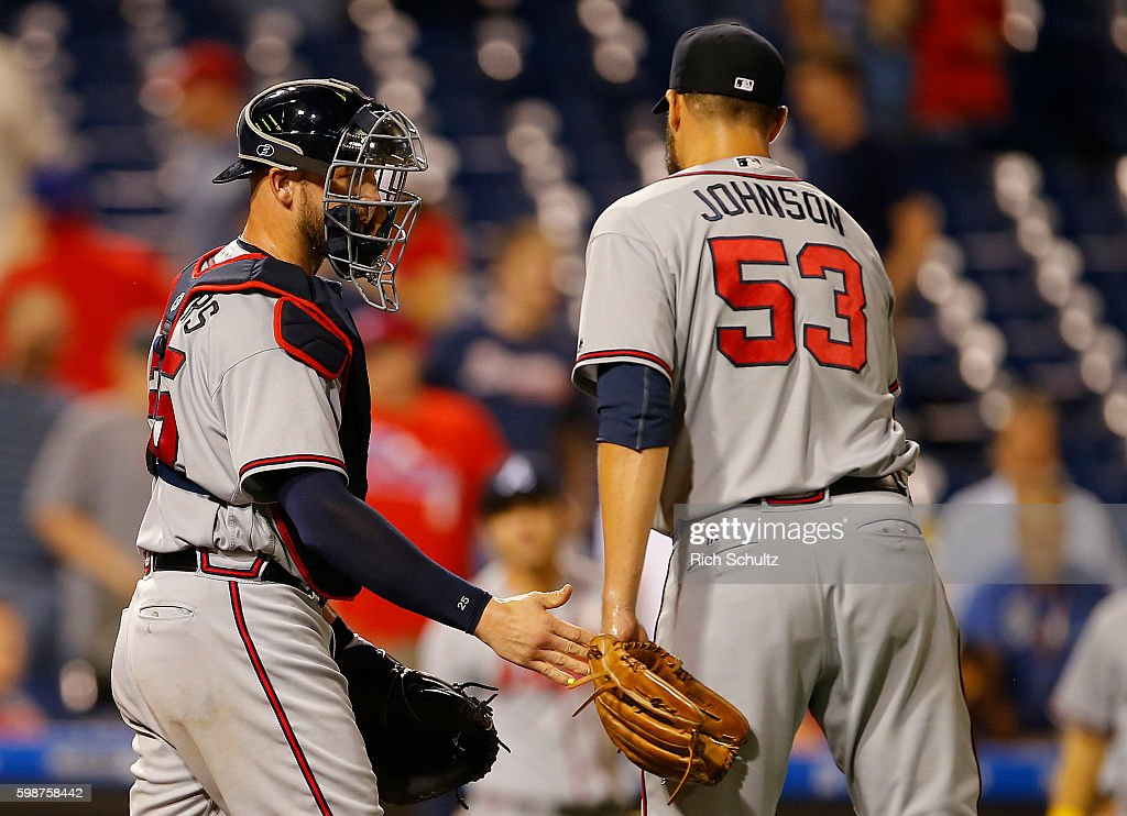 Catcher Tyler Flowers #25 of the Atlanta Braves congratulates pitcher Jim Johnson #53 after defeating the Philadelphia Phillies 8-4 during a game at Citizens Bank Park on September 2, 2016 in Philadelphia, Pennsylvania.