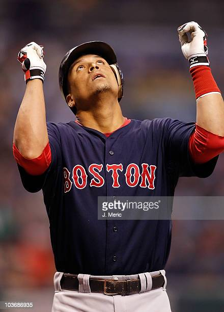 Catcher Victor Martinez of the Boston Red Sox celebrates after his first inning home run against the Tampa Bay Rays during the game at Tropicana...