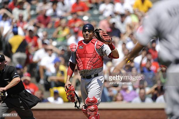 Catcher Victor Martinez of the Boston Red Sox fields his position as he calls a foul pop fly for the first baseman during the game against the Texas...