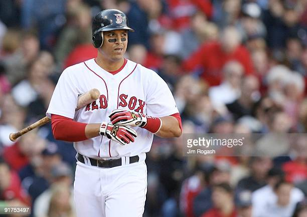 Catcher Victor Martinez of the Boston Red Sox reacts after striking out looking in the seventh inning against the Los Angeles Angels of Anaheim in...