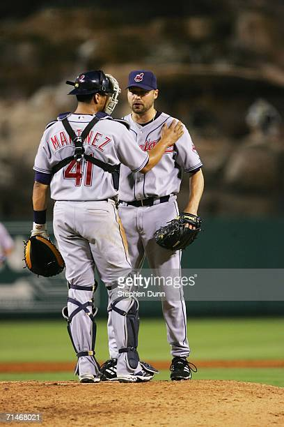 Catcher Victor Martinez of the Cleveland Indians confers with pitcher Jake Westbrook during the game against the Los Angeles Angels of Anaheim July...
