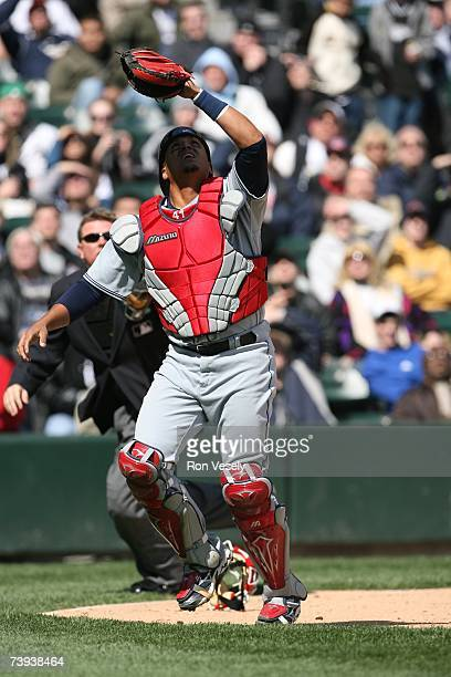 Catcher Victor Martinez of the Cleveland Indians plays a fly ball during the game against the Chicago White Sox at U.S. Cellular Field in Chicago,...