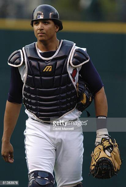 Catcher Victor Martinez of the Cleveland Indians walks on the field during the game against the Anaheim Angels on September 4, 2004 at Jacobs Field...