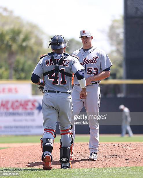 Catcher Victor Martinez of the Detroit Tigers talks with pitcher Kyle Lobstein during the second inning during the game against the Toronto Blue Jays...