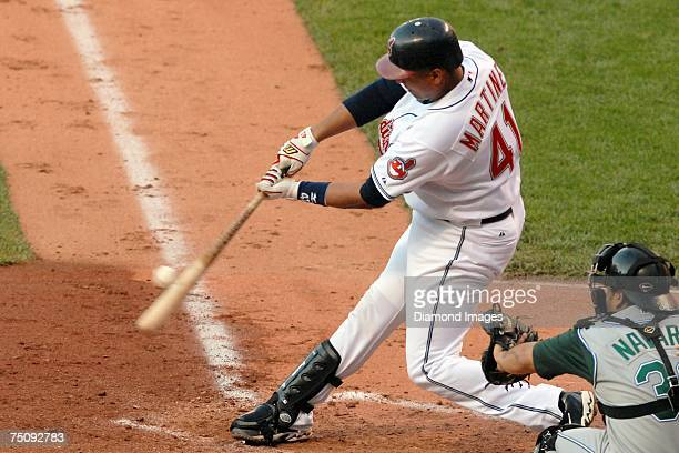 Catcher Victor Martinez singles as Tampa Bay Devil Rays catcher Dioner Navarro looks on during their game on Monday, July 2, 2007 at Jacob's Field in...