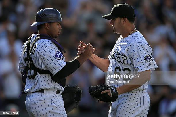 Catcher Wilin Rosario of the Colorado Rockies and pitcher Rafael Betancourt of the Colorado Rockies celebrate their victory over the San Diego Padres...