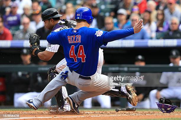 Catcher Wilin Rosario of the Colorado Rockies gets a force out on Anthony Rizzo of the Chicago Cubs at home plate at Coors Field on September 27 2012...