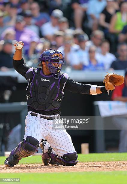 Catcher Wilin Rosario of the Colorado Rockies in action against the Minnesota Twins at Coors Field on July 13 2014 in Denver Colorado The Twins...