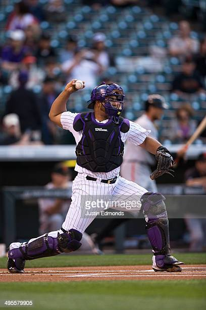 Catcher Wilin Rosario of the Colorado Rockies in action against the San Francisco Giants at Coors Field on May 20 2014 in Denver Colorado