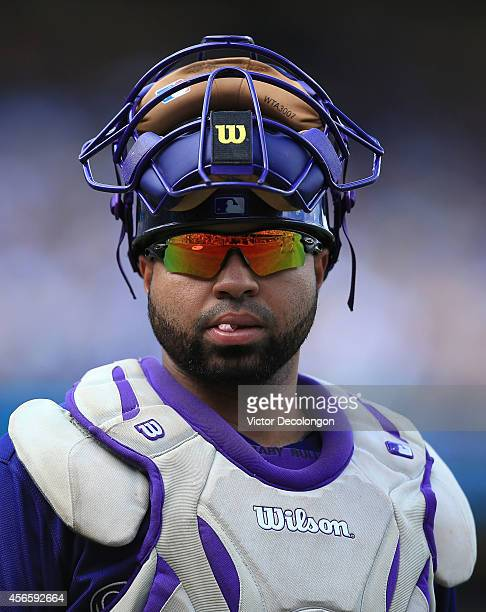 Catcher Wilin Rosario of the Colorado Rockies looks on after the second inning during the MLB game against the Los Angeles Dodgers at Dodger Stadium...
