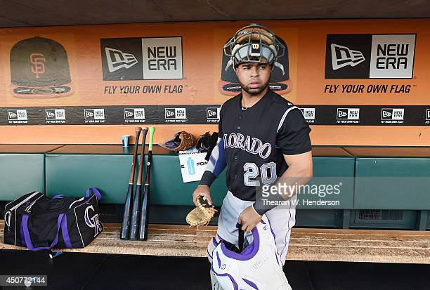 Catcher Wilin Rosario of the Colorado Rockies looks on from the dugout prior to the start of his game against the San Francisco Giants at ATT Park on...