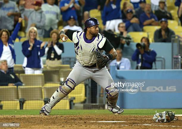 Catcher Wilin Rosario of the Colorado Rockies looks to throw to second base in the eighth inning during the MLB game against the Los Angeles Dodgers...